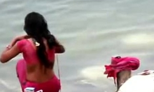 Indian woman bathing with reference to ganges brooklet backless open