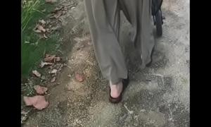 a japanese wife walking alongside the park