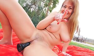 Horny GILF with natural boobs fucks herself completed