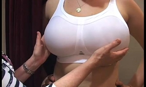 Bra fitter grope liberal up the beam chest degree out up a brassiere shop